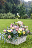 Basket with gerbera and rose flowers Royalty Free Stock Photography