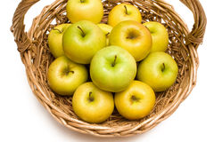 Basket With Golden Apples Stock Photos