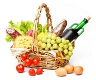 Basket of goods. On white background stock photo