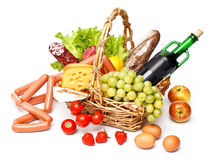 Basket of goods. On white background Royalty Free Stock Photos