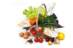Basket of goods with raw sturgeon Stock Images