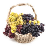A basket of grapes. On white background in studio Stock Photos