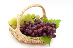 Basket with Grapes Stock Photos