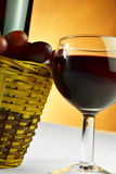 Basket of grapes and glass of wine Royalty Free Stock Photos