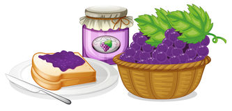 A basket of grapes, jam and a sandwich Stock Image