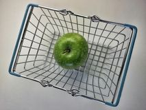 Basket with green apple inside Royalty Free Stock Images