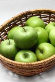 Basket of green apples Stock Photography