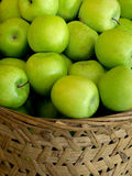 Basket of green apples Stock Image
