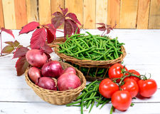 Basket of green beans with tomatoes and onions Royalty Free Stock Photo