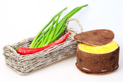 Basket with green onions and red peppers Royalty Free Stock Photos