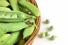 Basket with green peas Stock Photo