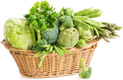Basket with green vegetables Stock Photo