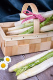 Basket with green and white asparagus with dark background Stock Photography
