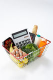 Basket of groceries and calculator Royalty Free Stock Image