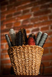 Basket with hair brushes Stock Photo