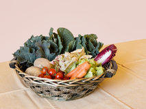 Basket hamper of fresh organic vegetables - carrots, tomatoes, c Stock Photography