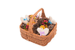 Basket with handmade hearts and cones Royalty Free Stock Photo