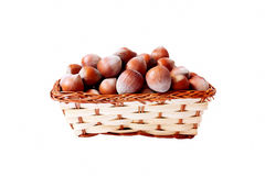 Basket with hazelnuts. Isolated basket with delicious and nutritious hazelnuts Stock Photography