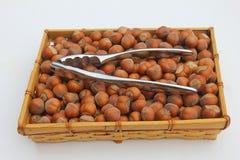 Basket with hazelnuts and nutcracker Stock Photography
