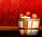 Basket Of Healthy Farm Fresh Fruit - Red Delicious. Gala & Pink Lady Apples ~ Red & Taupe Vintage or Antique Textured & Distressed Grunge Plaster Wall Royalty Free Stock Image