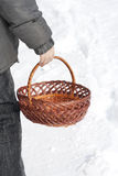 Basket in his hand. Empty shopping cart in the hand of man Stock Image