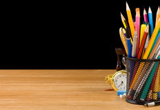 Basket holder and school supplies on black Stock Photography
