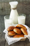 Basket with homemade cakes and a jug and two glasses of milk Royalty Free Stock Photo