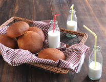 Basket of homemade dinner rolls and milk Stock Image