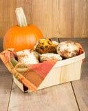 Basket of homemade pumpkin muffins Stock Image