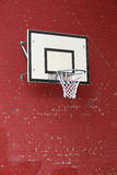 Basket hoop fixed on a red brick wall Stock Photography