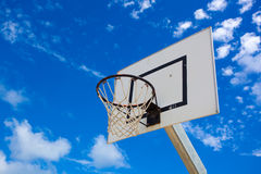 Basket hoop in a vibrant blue sky Stock Photo