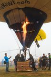 Basket of a hot air balloon. Pilot is releasing flame from burner royalty free stock photos