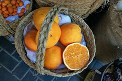 Basket of juicy oranges stock photos