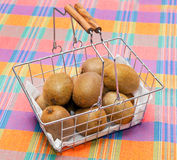 Basket of kiwi on tablecloth Royalty Free Stock Photos