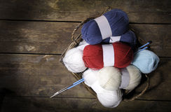 Basket with knitting wool on an old wooden floor Royalty Free Stock Photos