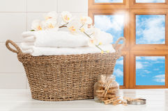 Basket Of Laundry. Basket of freshly laundered towels in sunlit kitchen window Royalty Free Stock Photography