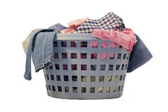 Basket Of Laundry. Blue laundry basket full of clean clothes and everything else Royalty Free Stock Image
