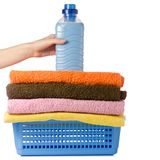 Basket with laundry towels bottle liquid powder conditioner softener in hand. Basket with laundry towels liquid bottle powder conditioner softener in hand on Royalty Free Stock Photos