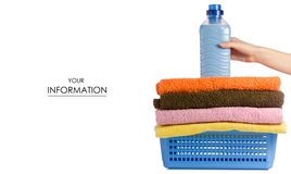 Basket with laundry towels liquid bottle powder conditioner softener in hand pattern. On white background isolation Stock Photo