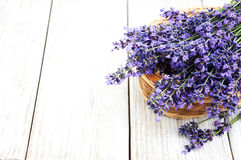 Basket with lavanda flowers. On a old woode table stock photos
