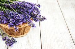 Basket with lavanda flowers. On a old woode table Stock Photography