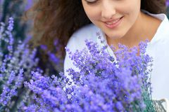 Basket with lavender flower is in woman hand royalty free stock photography
