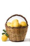 Basket of lemons. Isolated over white background Stock Photo