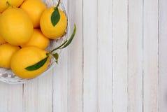 Basket of Lemons in Corner Stock Photos