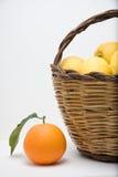 Basket of lemons and one orange royalty free stock photo
