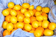 Basket of lemons. Basket of yellow lemons, close-up, on a napkin Stock Images