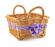 Basket with a lilac bow Stock Photos
