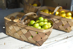 Baskets Of Limes. Basket of limes at a roadside fruit and vegetable stand stock photography