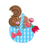 Basket with lollipops. Illustration of a checked pattern cloth basket full of lollipops and decorated with a ribbon and a tulip Royalty Free Stock Image