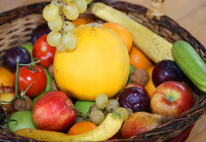 Basket with lots of fresh fruit in autumn season Royalty Free Stock Photos